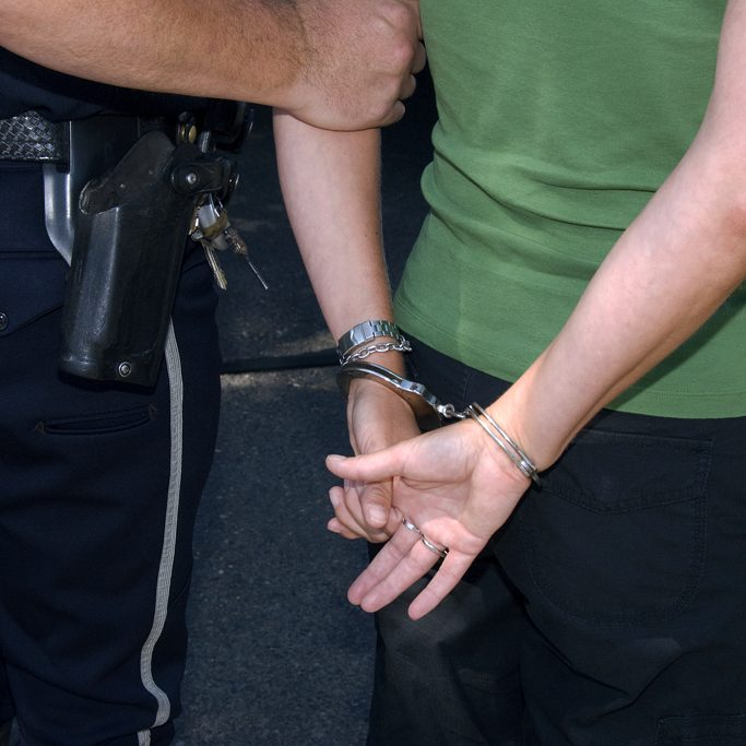 Officer arresting suspect